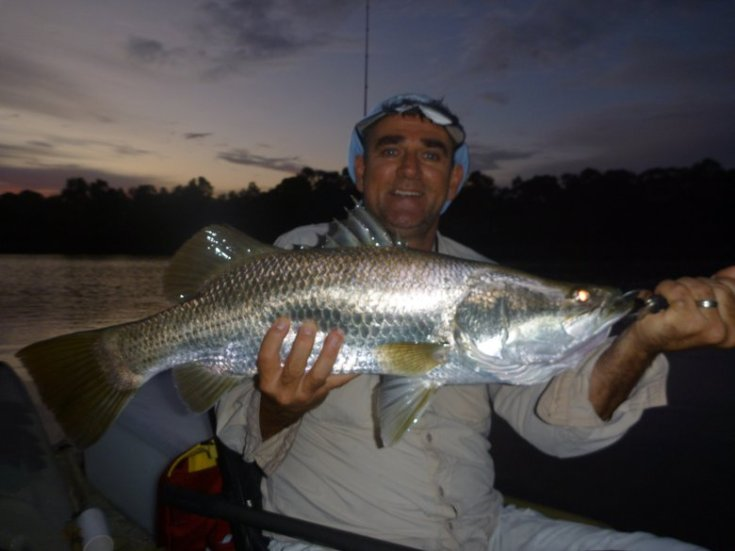 Shallow water winter barramundi on a Berkley powerbait in clear